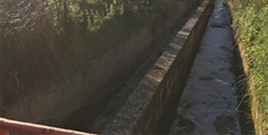 Channel constructed to divert water from two contaminated streams to a point of the Llobregat river downstream of the waterworks located in Sant Joan Despí, near Barcelona.